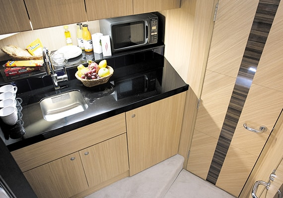 Galley is prepared installation space and storage place for cooking utensils. Table color is an example.