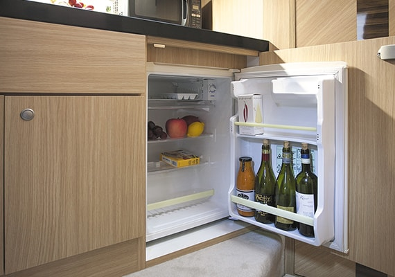 Put the refrigerator under the galley.
