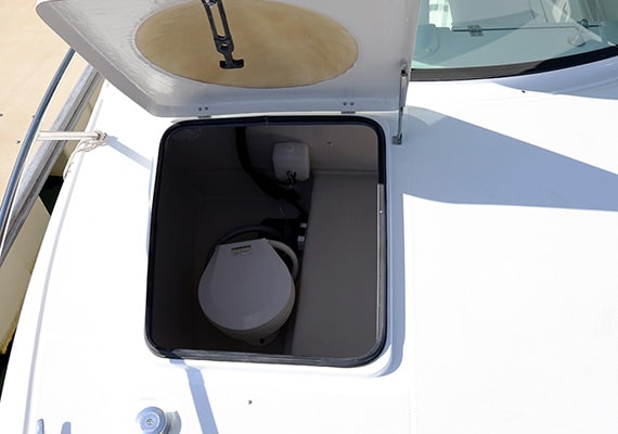 This is a special daylighting hatch. Located at the top of the electric marine toilet (opt).